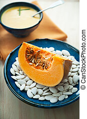 piece of pumpkin on a plate with pu