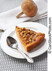 Piece of pumpkin pie with walnuts