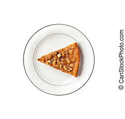 Piece of pumpkin pie with walnuts on a plate