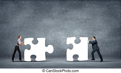 Piece of puzzle and business persons - Team of business...
