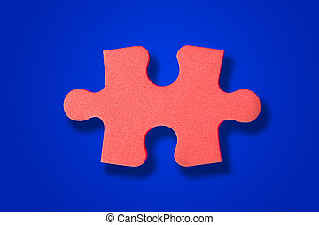 Piece of puzzle on blue