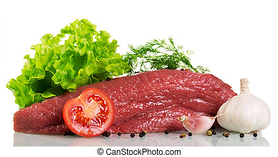 Piece of raw beef, tomato, lettuce, dill and spices isolated.