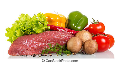 Piece of raw beef, vegetables, herbs and spices isolated.