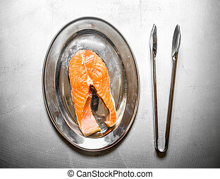 piece of raw salmon on a tray.