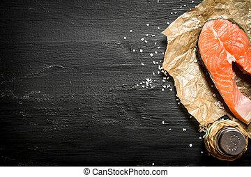 piece of raw salmon with salt.