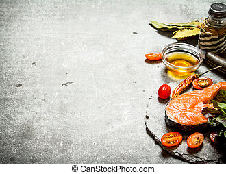 piece of raw trout and tomatoes.