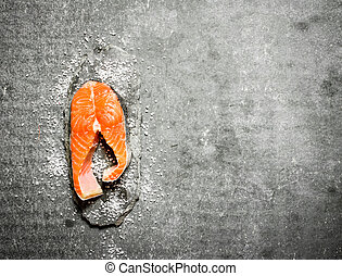 piece of raw trout with salt.