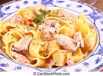 Piece of salmon fillet with tagliatelle, cream sauce and ...