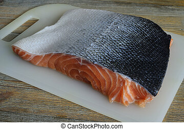 piece of salmon on a cutting board