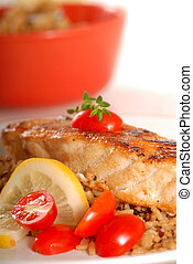 Piece of seared halibut over brown rice - Piece of seared...