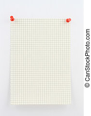 piece of squared paper pinned to a white wall with red pins