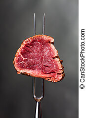 piece of steak on a meat fork
