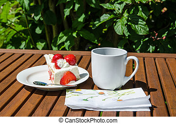 Piece of strawberry cake at a table