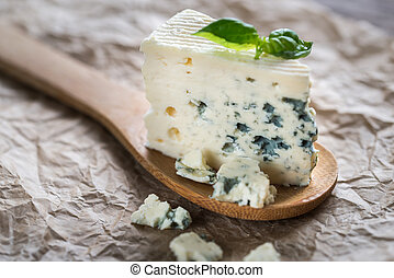 Piece of the blue cheese on the wooden spoon - Blue cheese