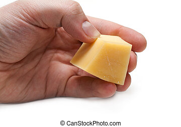 Piece of the cheese in hand