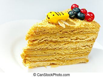 Piece of the honey cake decorated with a bee from glaze