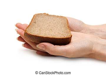 Piece of the pumpernickel in woman hands