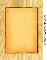 paper against wooden background
