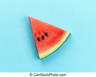piece of watermelon on blue background