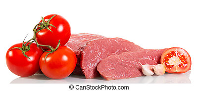 Piece raw beef, tomatoes and garlic isolated on white background.