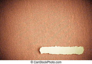 Piece scrap paper blank copy space on brown fabric textile material