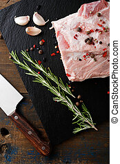 Piece Steak of Raw Pork Meat with spices, garlic and rosemary
