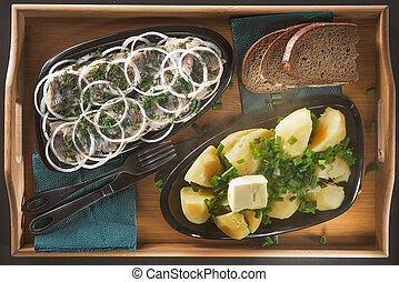 Pieces of a herring with rings of onions and fennel, hot...