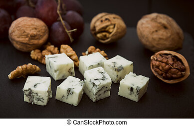 Pieces of blue cheese and walnuts