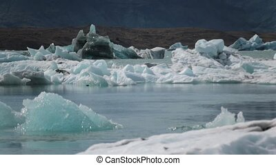 Pieces of blue ice float down the river. Andreev.