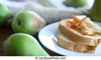 pieces of bread with sweet home-made fruit jam from pears...