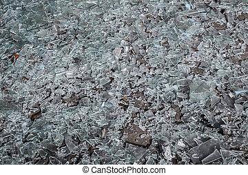 pieces of broken glass on the floor