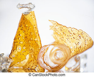 Pieces of cannabis oil concentrate aka shatter isolated against white background
