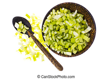 Pieces of celery in wooden bowl on white background, top view.