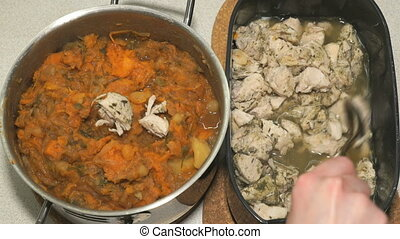 Pieces of chicken and vegetable ragout in saucepan - Adding...