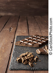 Pieces of chocolate on slate