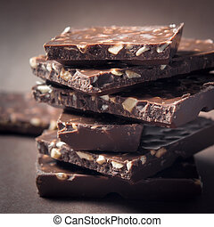 Pieces of chocolate. - Stack of pieces sweet chocolate with...