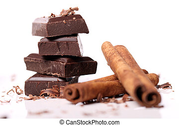 Pieces of chocolate with cinnamon sticks