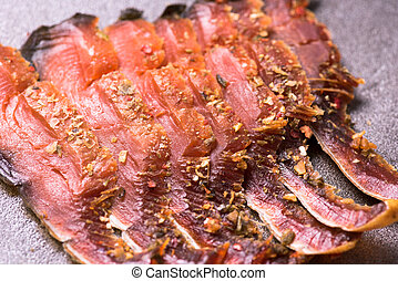 Pieces Of Cold Smoked Pink Salmon. Close-Up on the table