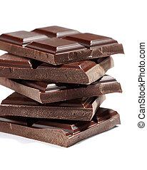 pieces of dark chocolate on white