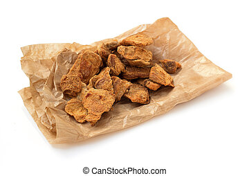 pieces of dried meat  on paper bag
