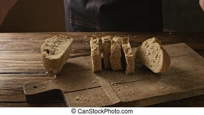 Pieces of fresh bread baked on a wooden board with bread ...