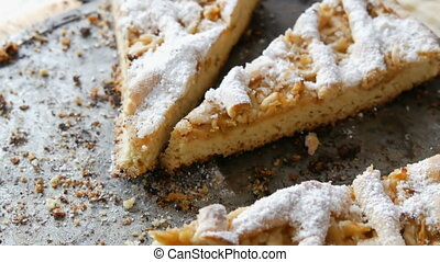 Pieces of half-eaten pie on a table. Homemade baking. Apple...