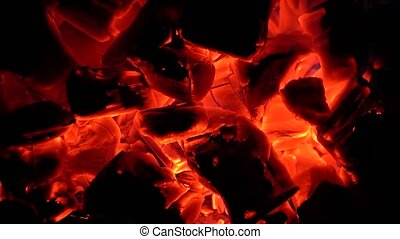Pieces of hot coals begin to glow from inflating.