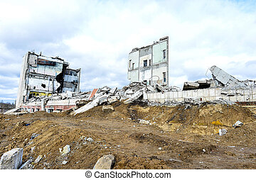 Pieces of Metal and Stone are Crumbling from Demolished Building