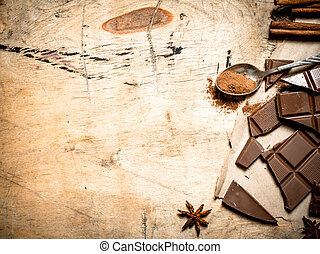 Pieces of milk chocolate with cocoa and cinnamon.