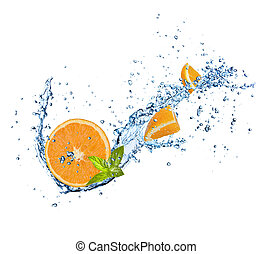 Pieces of orange in water splash on white
