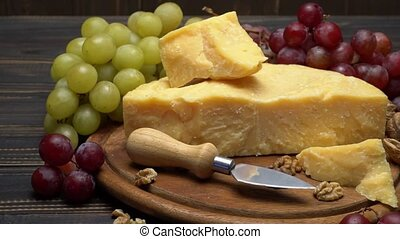 pieces of parmesan or parmigiano cheese and grapes - pieces...