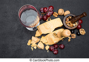 pieces of parmesan or parmigiano cheese, wine and grapes