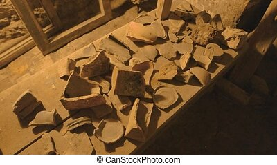 Pieces of pottery, old tools. Archaeological finds top view....