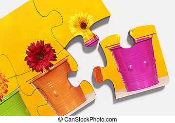 pieces of puzzle with potted flowers